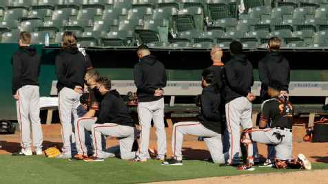 Giants manager Gabe Kapler, players kneel during anthem